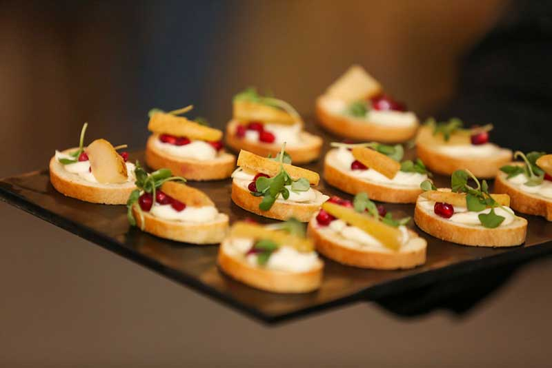 Pear, brie, and cranberry bites at wedding