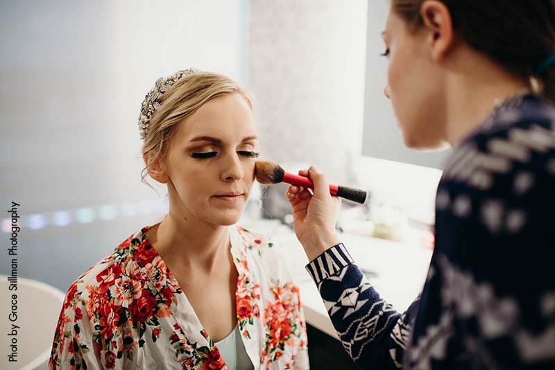 Bride gets makeup down for wedding day at Intercontinental Hotel MSP
