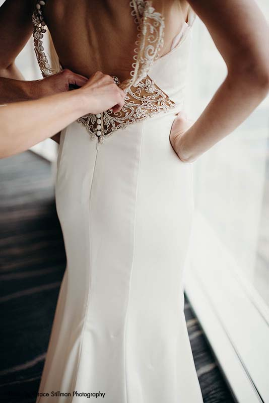 Bride gets ready in hotel wedding room