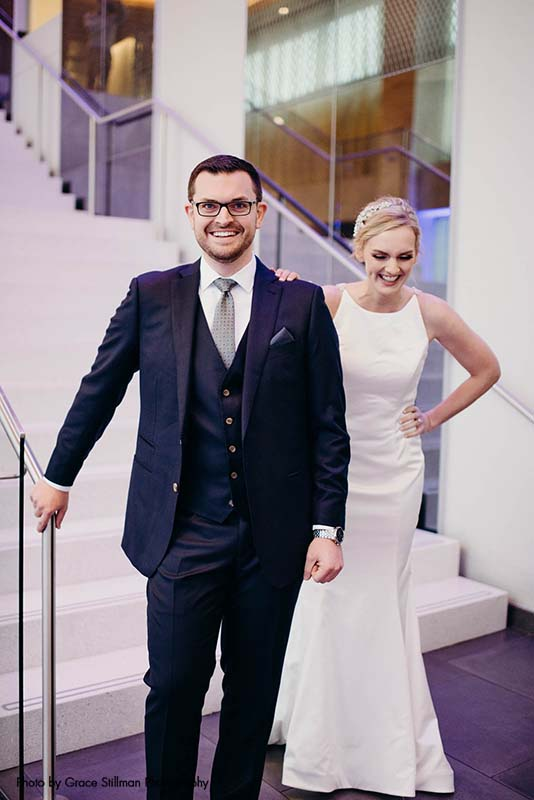 Bride and groom share first look on stairs at hotel wedding