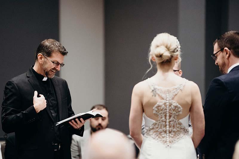 Couples marries in hotel wedding ballroom