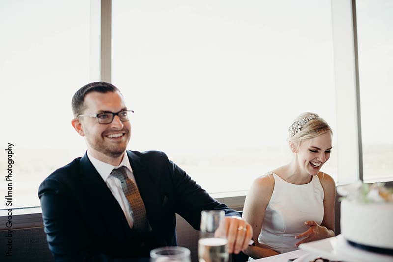 Couple sits at sweetheart table for wedding
