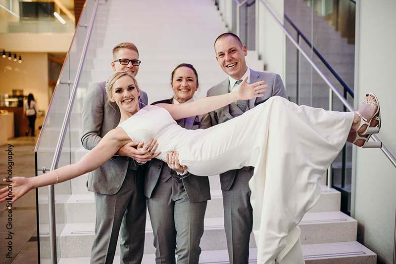 Bride poses with groomsmen