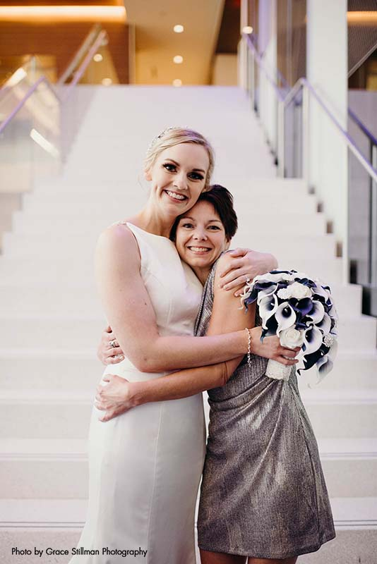 Bride poses with mother at wedidng