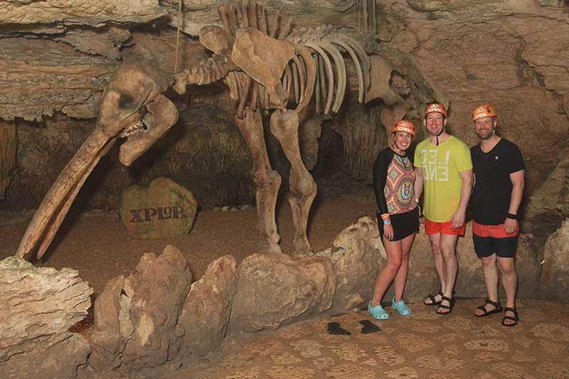 Group explores river under cave
