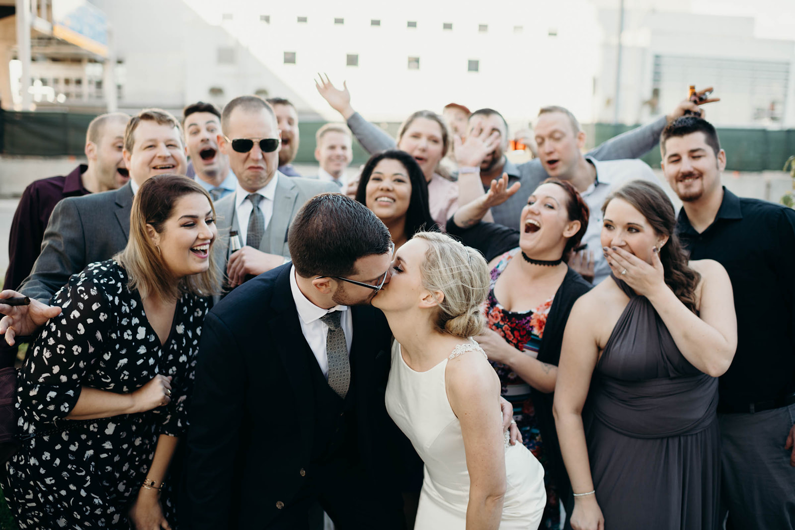 Bride and groom celebrate with friends following wedding ceremony