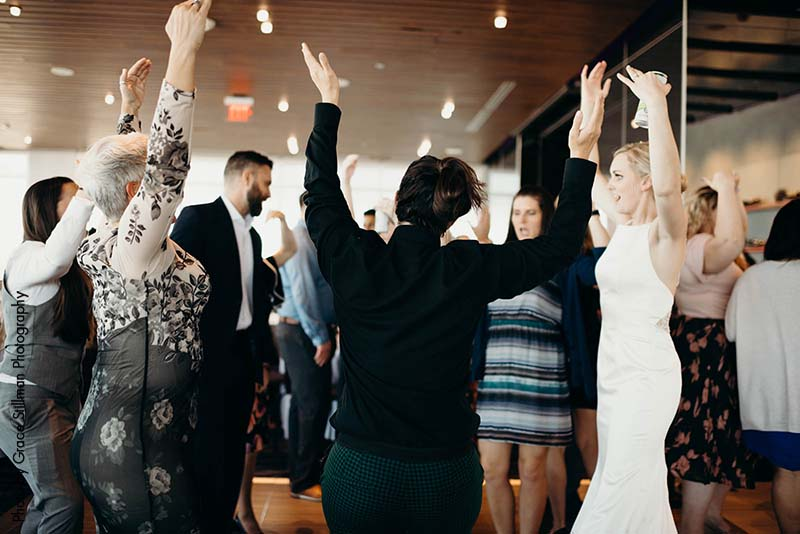 Guests dance at daytime wedding reception at Intercontinental MSP Airport hotel