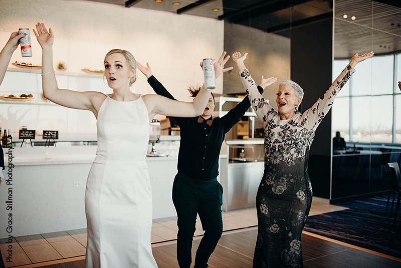 Wedding guests dance at daytime reception