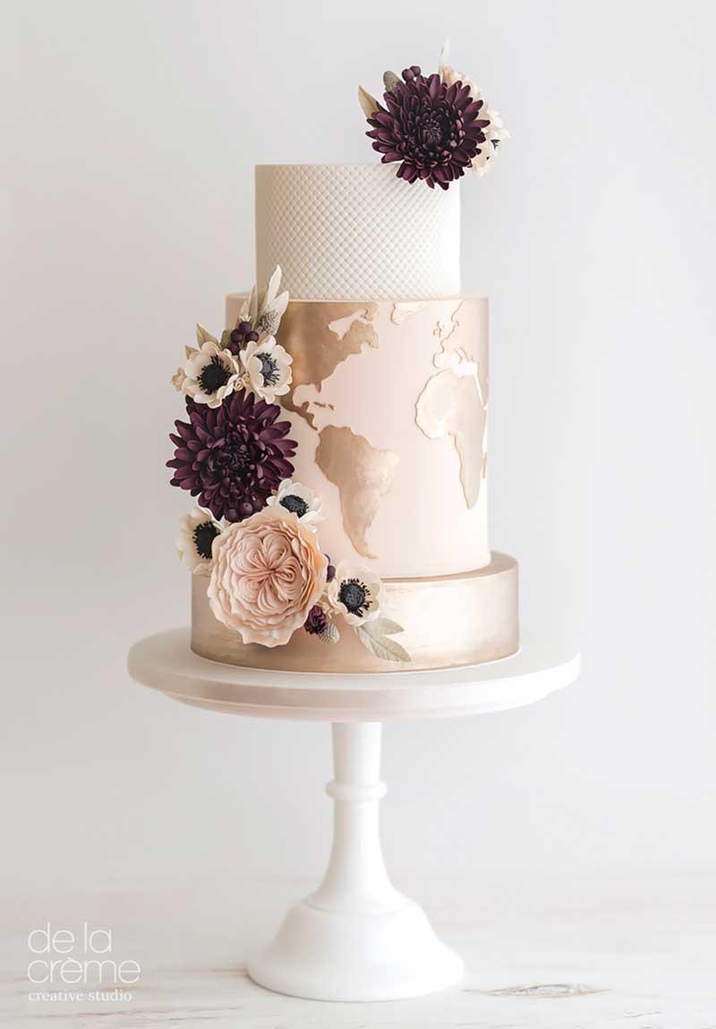 Gold globe wedding cake by De La Creme