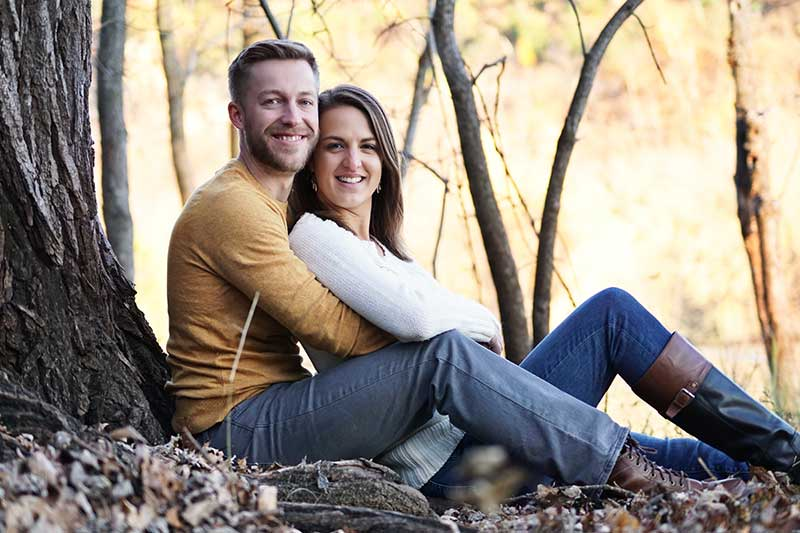 Couple sits for fall engagement photoshoot