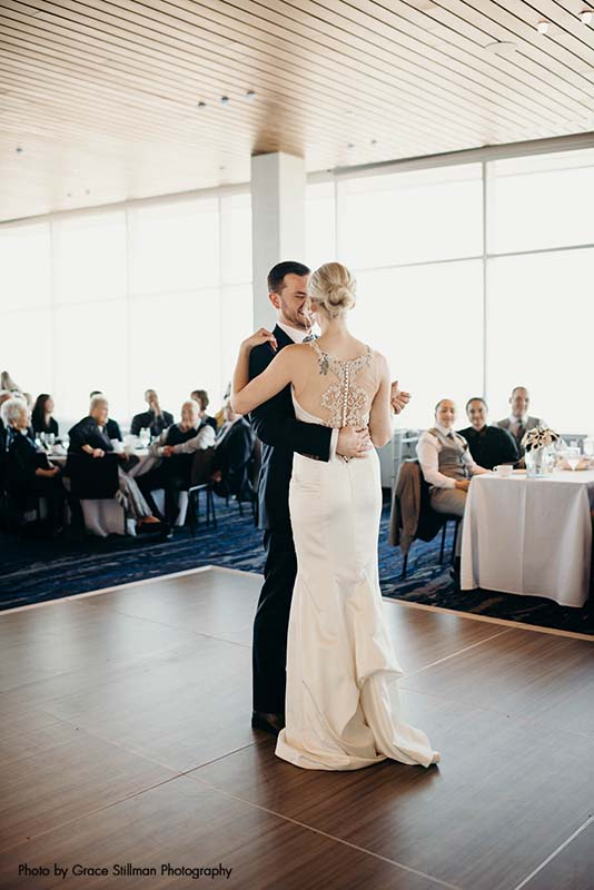 Bride and groom share first dance at brunch wedding