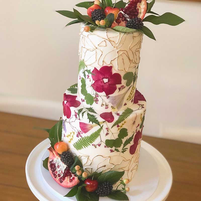 Fern and pressed floral fall wedding cake by Flourish Cake Design