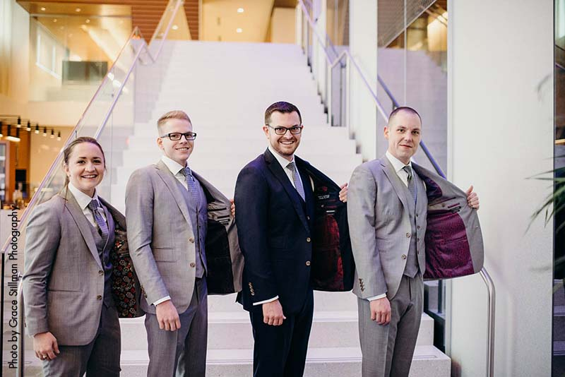 Groom with groomsmen and bridesmaid in gray suits