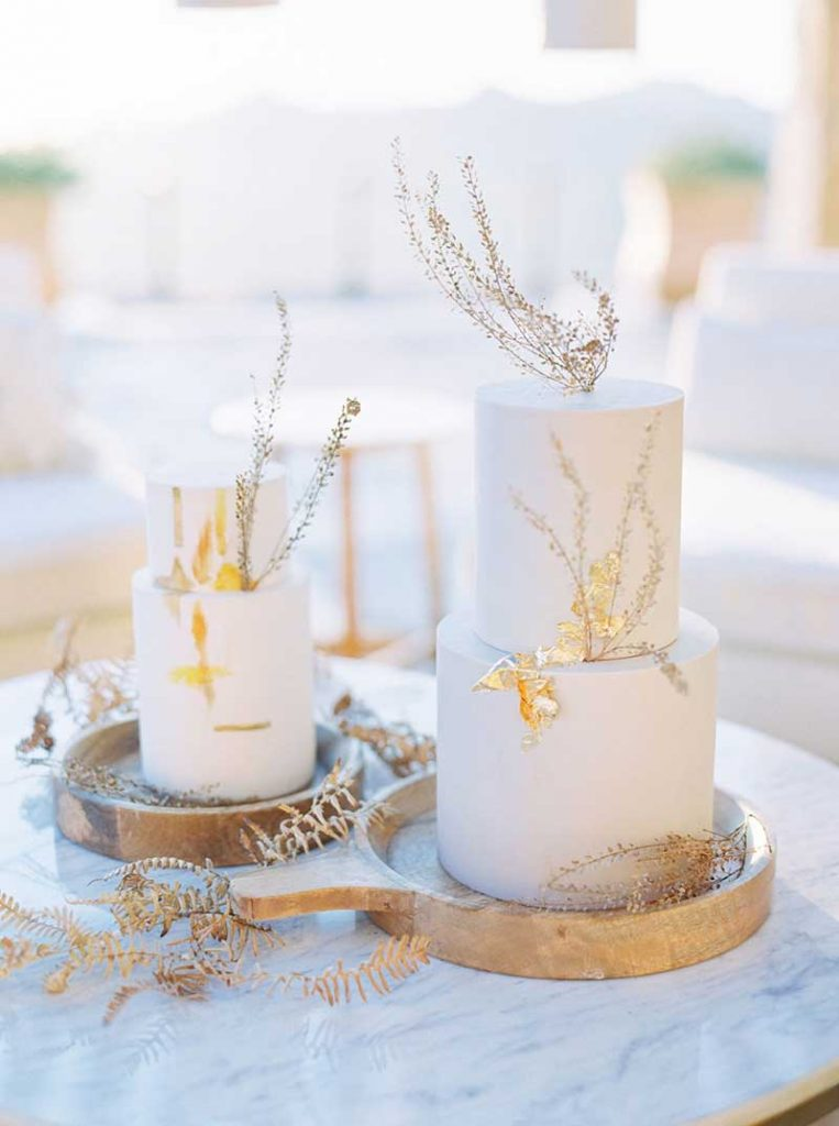 White fall wedding cake with gold foil by Hey There Cupcake