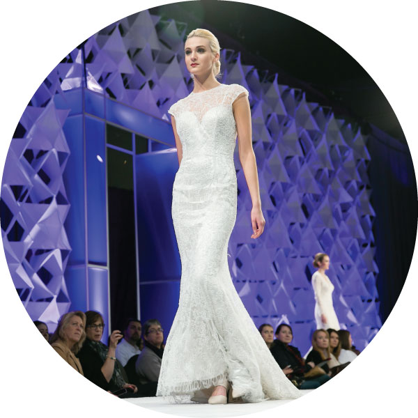 Model walks down bridal fashions show runway