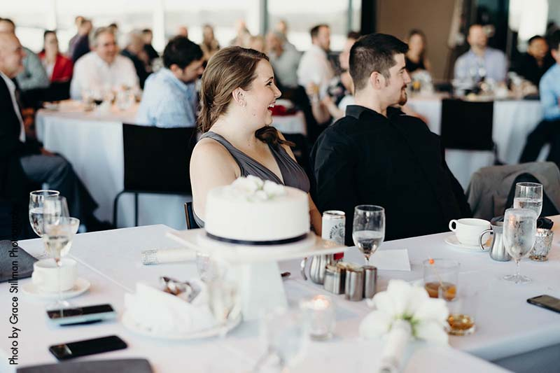 Guests laugh at daytime wedding