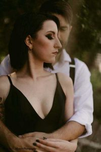 Couple poses at outdoor wedding