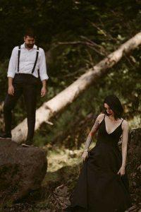 Bride and groom walk through trees