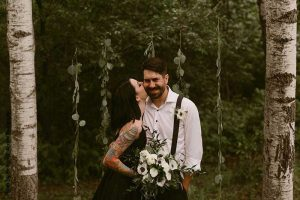 Bride and groom at dark wedding ceremony