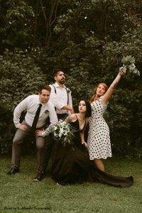 Wedding party poses for fun photo