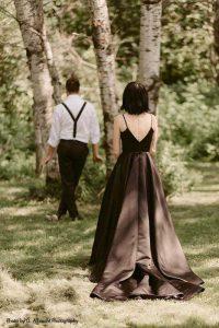 Bride wears dark wedding dress for first look