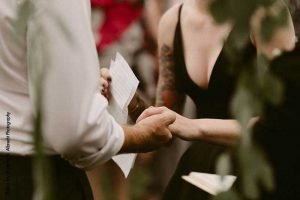 Bride and groom exchange vows outdoors