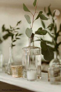 Eucalyptus in vase at dark wedding
