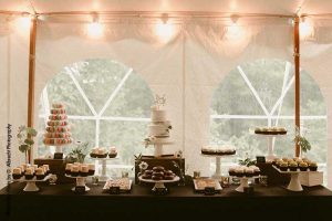 Dessert display with cakes, cupcakes, and macarons