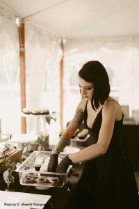 Bride prepares desserts at wedding