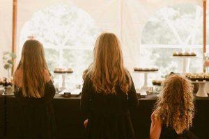 Flower girls in dark wedding dresses