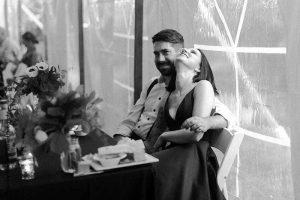 Bride and groom at dark wedding reception