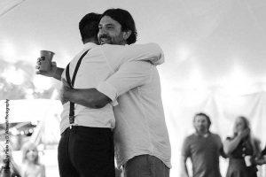 Groom hugs best man after speech