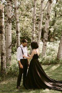 Bride and groom stand by birch trees in backyard dark wedding