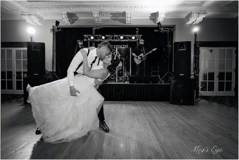 Bride and groom dance to live band at wedding