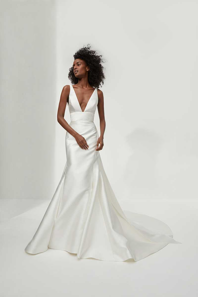 Low cut minimalist fit and flare bridal fashion gown