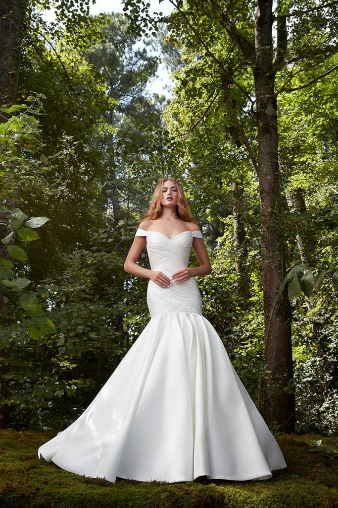 Fit and flare off the shoulder wedding gown by Anne Barge