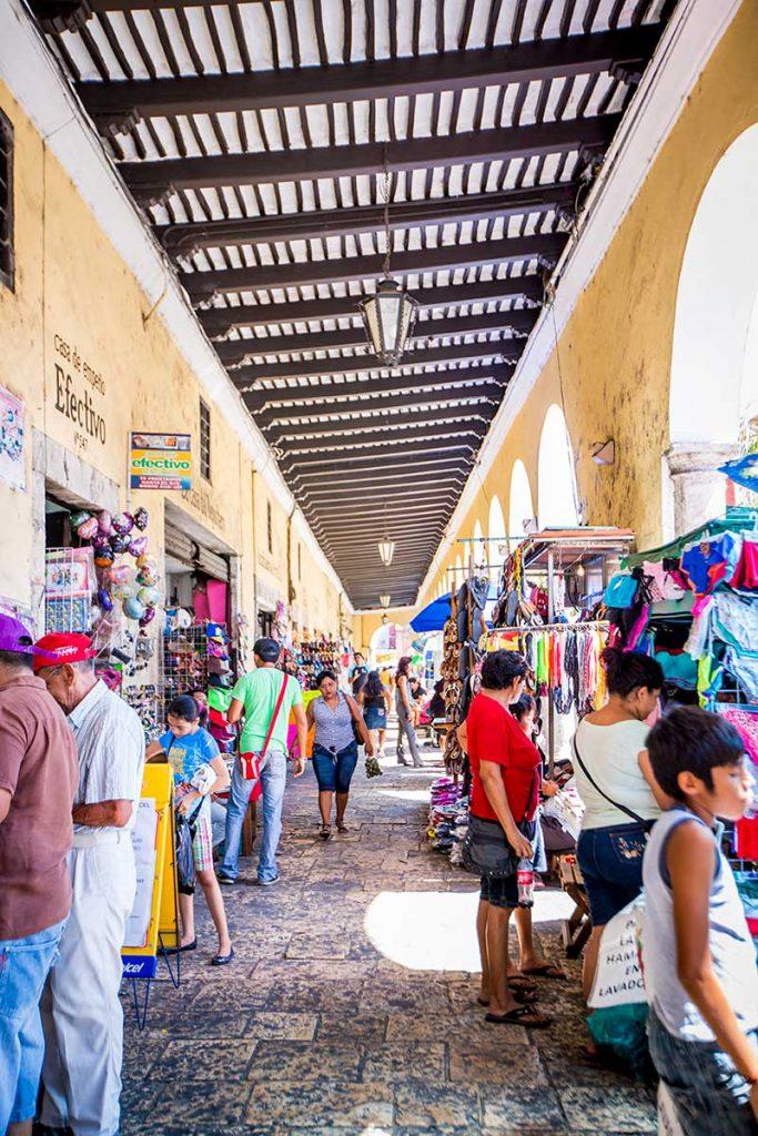 Residents explore mercado in Mérida