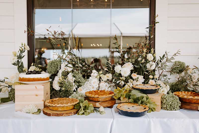 Harvest style catering pie bar at wedding