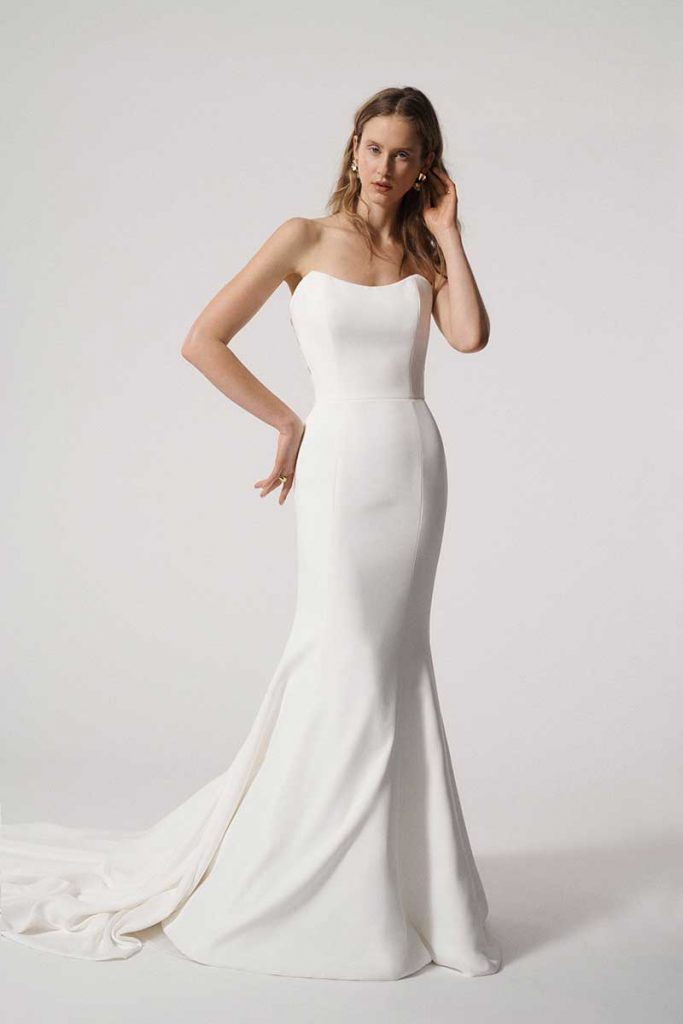 Strapless bridal gown with lace detail in back