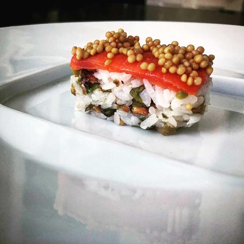 Salmon main course with pistachios and golden raisins