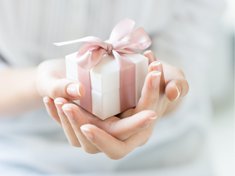 Small gift with white box and pink bow