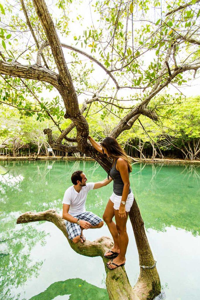 Couple explores cenote in the State of Yucatan