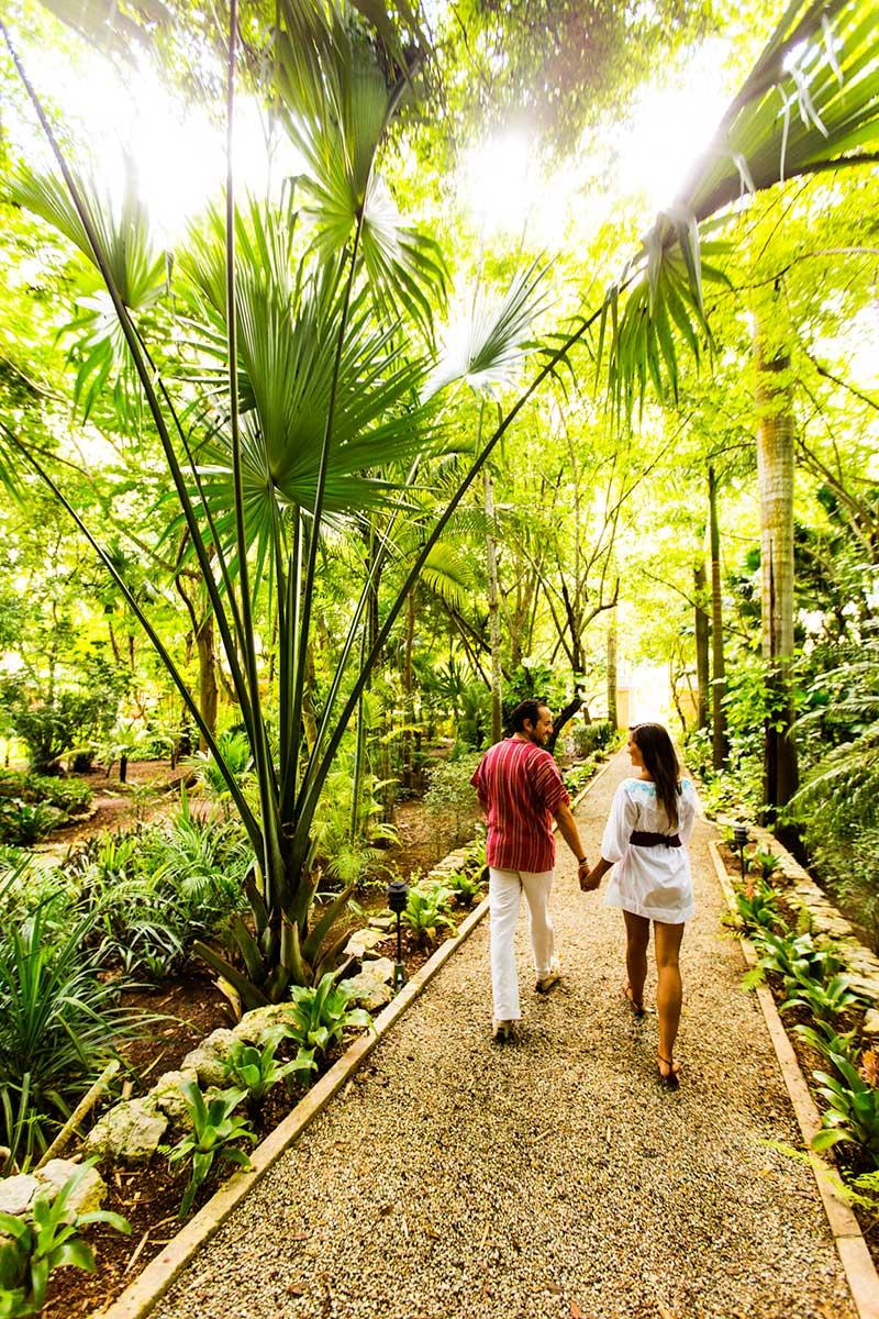 Couple walks through a hacienda in the State of Yucatan