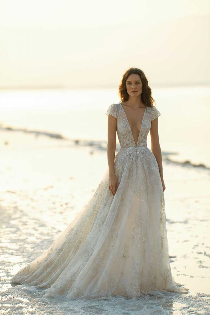 Low cut 2021 bridal fashion trends gown