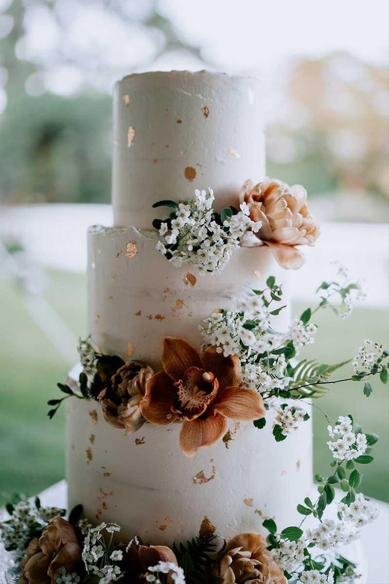 Bronze splatter floral fall wedding cake by Buttercream Bakery