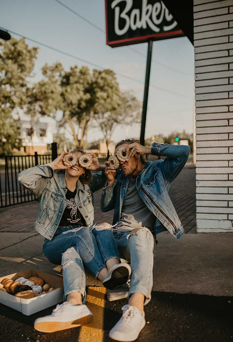 Couple takes photos with donuts by MVphotos