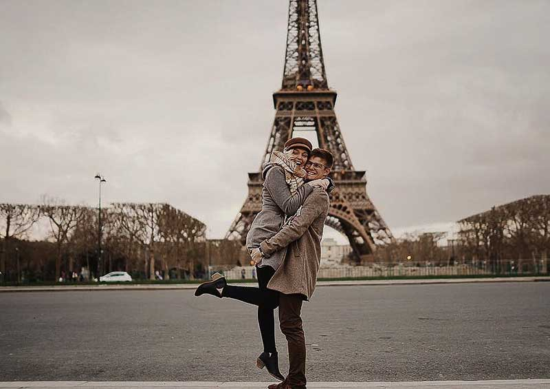 MVphotos duo Madalyn and Logan stand in front of Eifel Tower