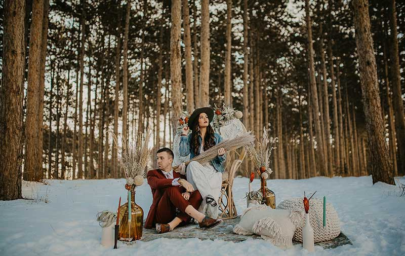 Boho couple poses for winter outdoor styled shoot
