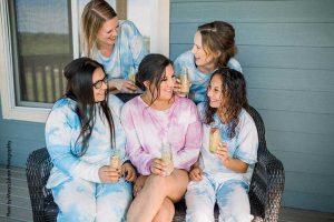 Brides and bridesmaids in tie-dye pajamas
