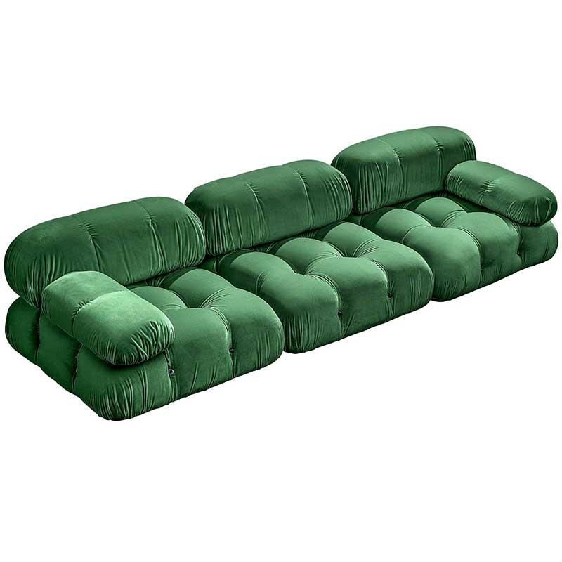 Couch with tufted green velvet